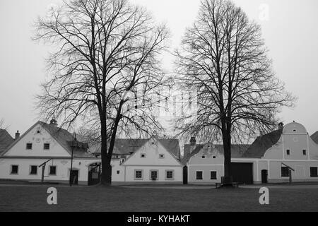 Old houses in the South Bohemian Folk or Rural Baroque style (18th- and 19th-century) in Holasovice village, South - Stock Photo