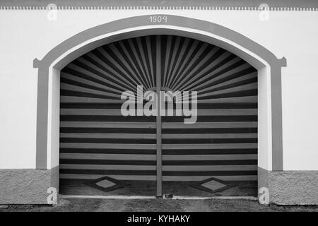Painted wooden gate of a house in the South Bohemian Folk or Rural Baroque style (18th and 19th-century) in Holasovice - Stock Photo