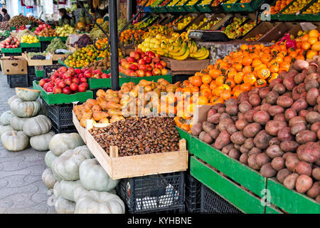 Seasonal fruits and vegetables - potatoes, pumpkins, chestnuts, mandarins, persimmons, apples, bananas and other - Stock Photo