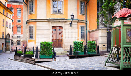 Stockholm, Sweden beautiful cobblestone street and buildings in historic district Gamla Stan. Quaint old public - Stock Photo