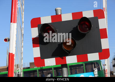 Close-up of railway crossing warning lights in Chichester, West Sussex, UK. - Stock Photo
