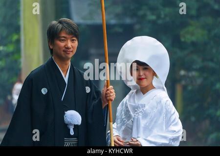 NAGOYA, JAPAN - NOVEMBER 18, 2015: Unidentified Japanese couple attends a Japanese traditional wedding ceremony at Atsuta-jingu shrine Stock Photo