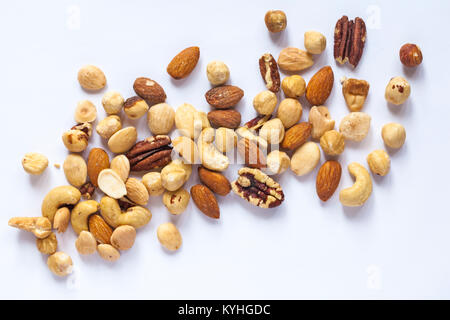 Tesco finest roasted nut selection spread out isolated on white background. Mixed roasted nuts delicately seasoned - Stock Photo