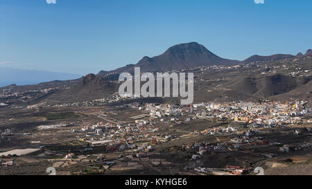 Views from Mirador La Centinela towards Valle San Lorenzo village, mountain formation Roque del Conde, and the island - Stock Photo