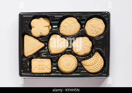 Tin of Tesco all butter Scottish Shortbread Assortment with lid off to show shortbread biscuits inside set on white - Stock Photo