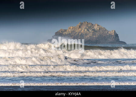 An island off the North Cornwall Coast - Newlands Island off the coast of Polzeath in Cornwall. - Stock Photo