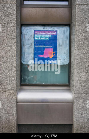 Poster informing customers of Royal Bank of Scotland about a branch closure, Victoria Road, Glasgow, Scotland. - Stock Photo