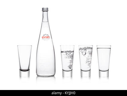 LONDON, UK - JANUARY 10, 2018:  Glass bottle of Pure Evian Natural Mineral Water on a white background. Made in - Stock Photo