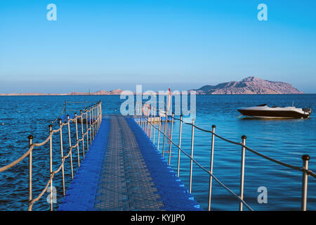 pontoon in the Red Sea, boat and Tiran Island - Stock Photo