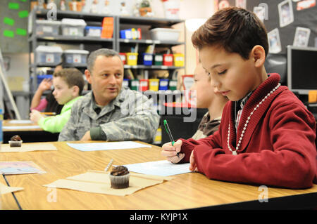 Austin Gozalez, a fourth-grade student at Clear Creek Elementary School in Shelbyville, Ky., writes a letter to - Stock Photo