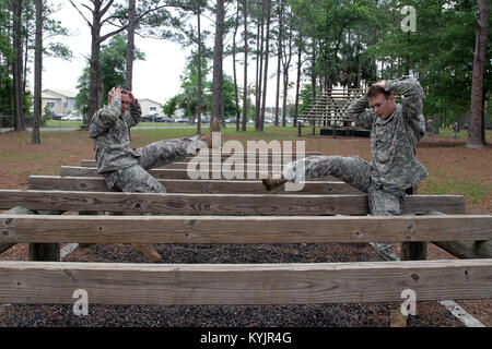 South Carolina Guardsman, Spc. Aaron Drummer (right), a native of Anderson County, Ky., competes in the 2014 National - Stock Photo