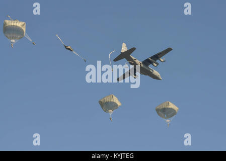 U.S., British, Dutch and Polish troops parachute from a Kentucky Air National Guard C-130 near Groesbeek, Netherlands, - Stock Photo