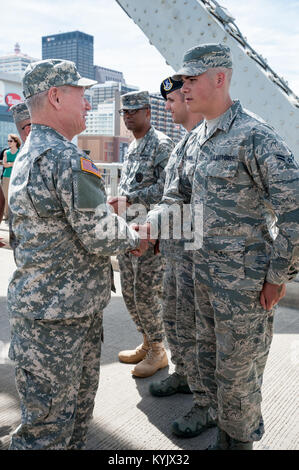 Army Gen. Frank J. Grass, chief of the National Guard Bureau, speaks to a Airman from the Kentucky Air National - Stock Photo