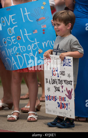Declan Gilreath, 3, waits for his father, 1st Lt. Joshua Gilreath, to step off a C-130 Hercules aircraft at the - Stock Photo