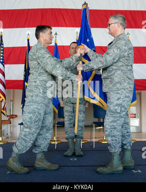 Col. David Mounkes (right), the new commander of the 123rd Airlift wing, accepts the wing guidon from Brig. Gen. - Stock Photo