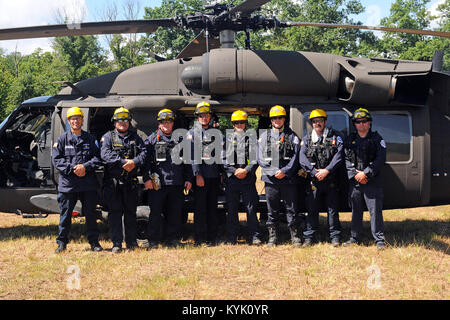 Members of the Bluegrass Emergency Response Team pose for a photo in front of a UH60 Blackhawk during their joint - Stock Photo