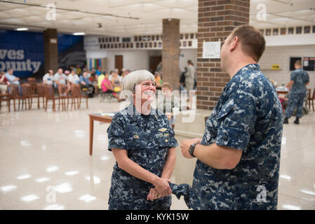 U.S. Navy Rear Adm. Priscilla Coe (left), deputy chief of staff for the U.S. Navy Bureau of Medicine and Surgery - Stock Photo