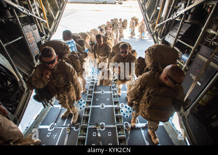 U.S. Marines board a Kentucky Air National Guard C-130 Hercules at Guelmime Airport in Morocco on April 27, 2017, - Stock Photo