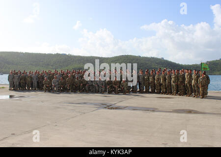 Soldiers with the 940th Military Police Company take a group photo with members of the Virgin Islands Police Department - Stock Photo