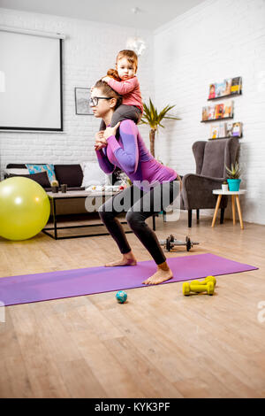 Mother doing sports with her baby son - Stock Photo