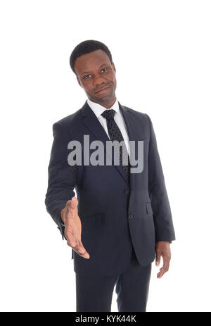 A close up image of a business man in a dark suit greeting somebody  with the hand out stretched , isolated for - Stock Photo