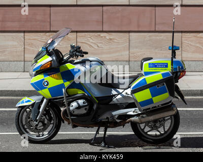 Parked Metropolitan Police motorcycle in the City of London, England, United Kingdom - Stock Photo