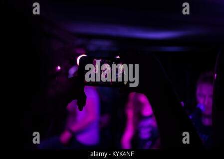 Audience recording live performance with smartphone - Stock Photo