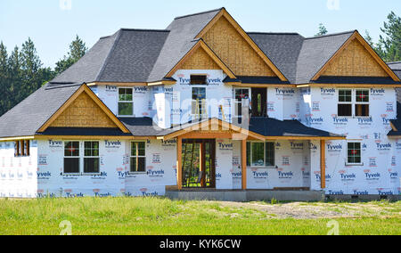 Large home under construction in the beautiful Pacific Northwest countryside of Bellingham, Washington, USA. A construction - Stock Photo