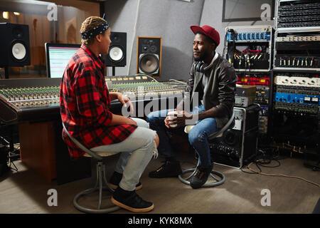Talk in sound record studio - Stock Photo