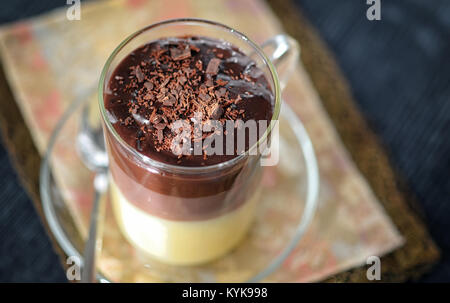 Triple chocolate layer mousse cake on vintage table - Stock Photo