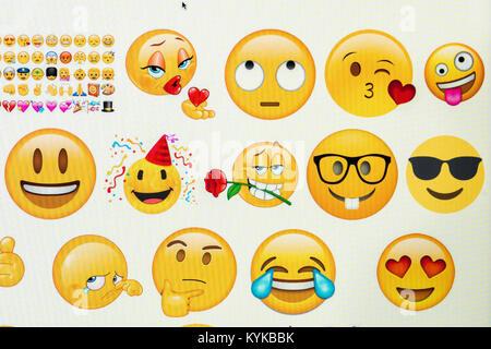 Emoji on computer screen. - Stock Photo