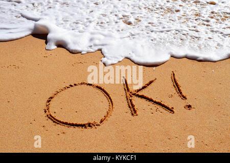 Ok written in sand - Stock Photo