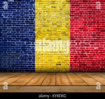 Chad flag painted on brick wall with wooden floor - Stock Photo