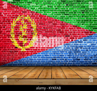 Eritrea flag painted on brick wall with wooden floor - Stock Photo