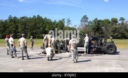Troops from the Kentucky Air National Guard's 123rd Civil Engineer Squadron join with other Airmen to anchor a Mobile - Stock Photo
