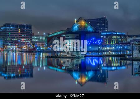 National Aquarium in Baltimore reflected in water. Baltimore Inner harbor - Stock Photo