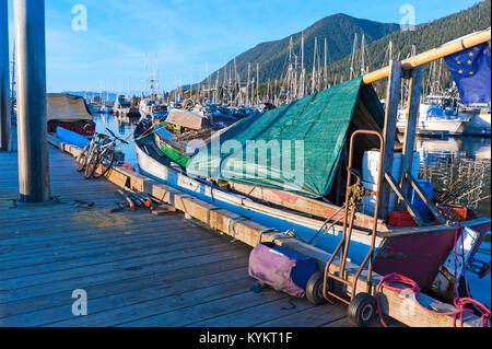 Firewood on dock beside live aboard boat in Thomsen Harbor in Sitka, Alaska, USA - Stock Photo