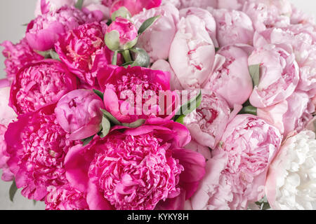 Elegant bouquet of a lot of peonies of pink color close up. Beautiful flower for any holiday. Lots of pretty and - Stock Photo