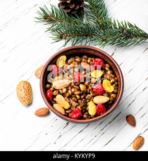 national ritual Christmas dish, a porridge with raisins and almonds, kutya - Stock Photo