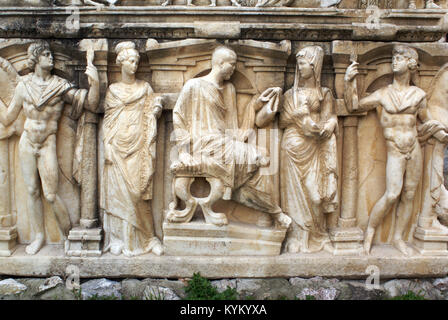 Statues of man and woman on the sarcophagus in Iznik, Turkey - Stock Photo
