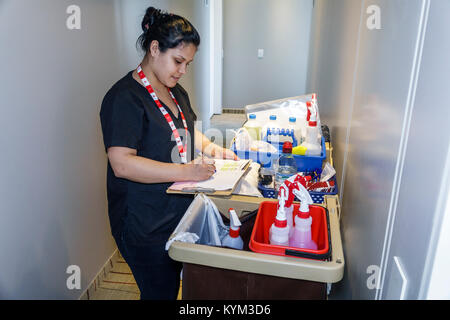 Buenos Aires Argentina Palermo Dazzler Polo hotel housekeeping maid cleaning cart job work Hispanic woman working - Stock Photo
