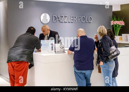 Buenos Aires Argentina Palermo Dazzler Polo hotel lobby front-desk clerk man woman guest Hispanic Argentinean Argentinian - Stock Photo