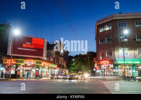 Buenos Aires Argentina,Palermo,night evening,traffic,street,intersection,pedestrian crossing,billboard,ad,Netflix,dusk,neon,Hispanic,ARG171119223