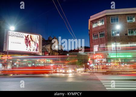 Buenos Aires Argentina,Palermo,night evening,light streaks,traffic,street,intersection,pedestrian crossing,billboard,ad,dusk,neon,Hispanic,ARG17111922