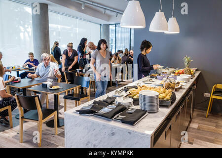Buenos Aires Argentina Palermo Dazzler Polo hotel free breakfast buffet dining room counter self-serve tables man - Stock Photo