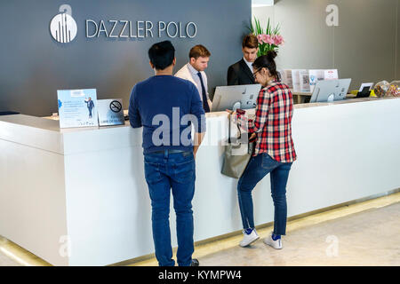 Buenos Aires Argentina Palermo Dazzler Polo hotel lobby front-desk clerk man woman couple guest Hispanic Argentinean - Stock Photo