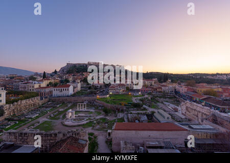 Athens ancient city with Hadrian's library and the Acropolis, at sunset, in Greece. - Stock Photo