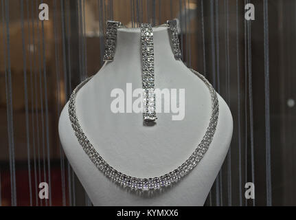 Elegant necklace on sale in retail shop - Stock Photo