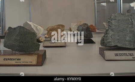 Various semi precious rocks displayed on exhibition with serbian tags - Stock Photo
