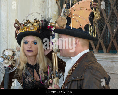 Couple in costumes and masks during the Venice carnival - Stock Photo